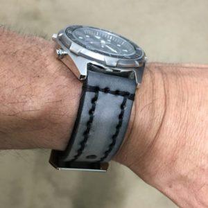 casio watch with gray stitched watchband